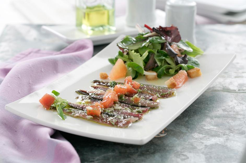 Sardinas marinadas con concasse de tomate
